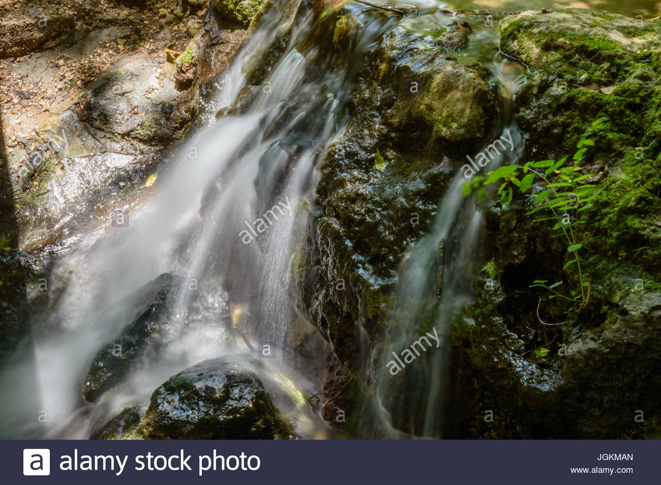 A relaxing look at the flowing spring fed water flowing over the rocks. - Stock Image