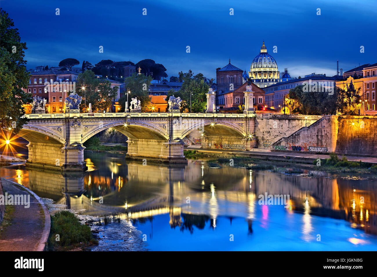 The dome of St Peter's Basilica and Ponte Vittorio Emanuele II, as seen from Ponte Sant'Angelo, Rome, Italy. - Stock Image