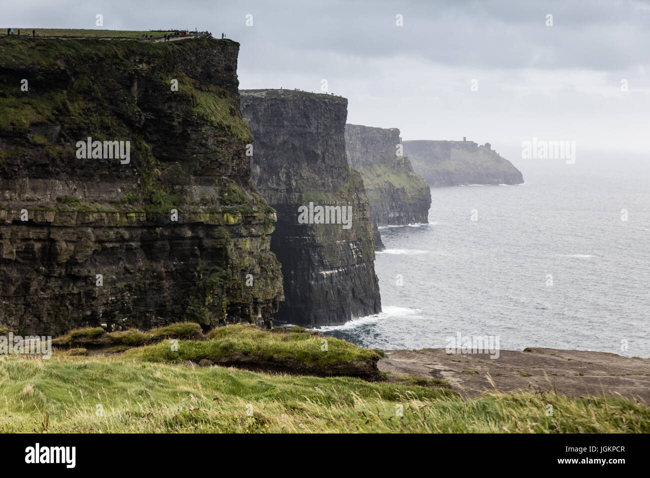 Cliffs of Moher in Ireland in a cloudy day - Stock Image