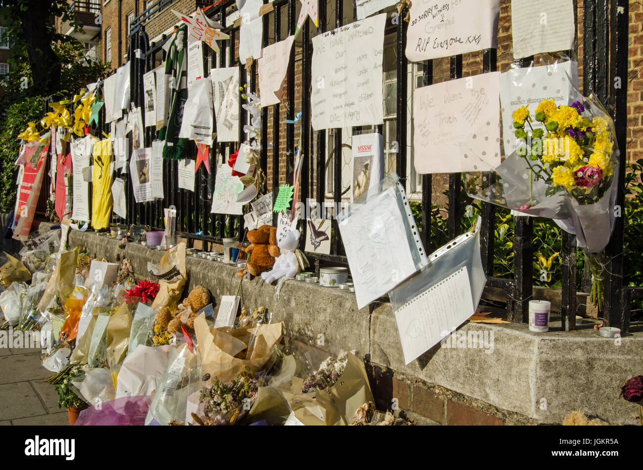 LONDON, UK - JULY 5, 2017: Railings close to Grenfell Tower covered in memorials to those killed and missing.  At - Stock Image