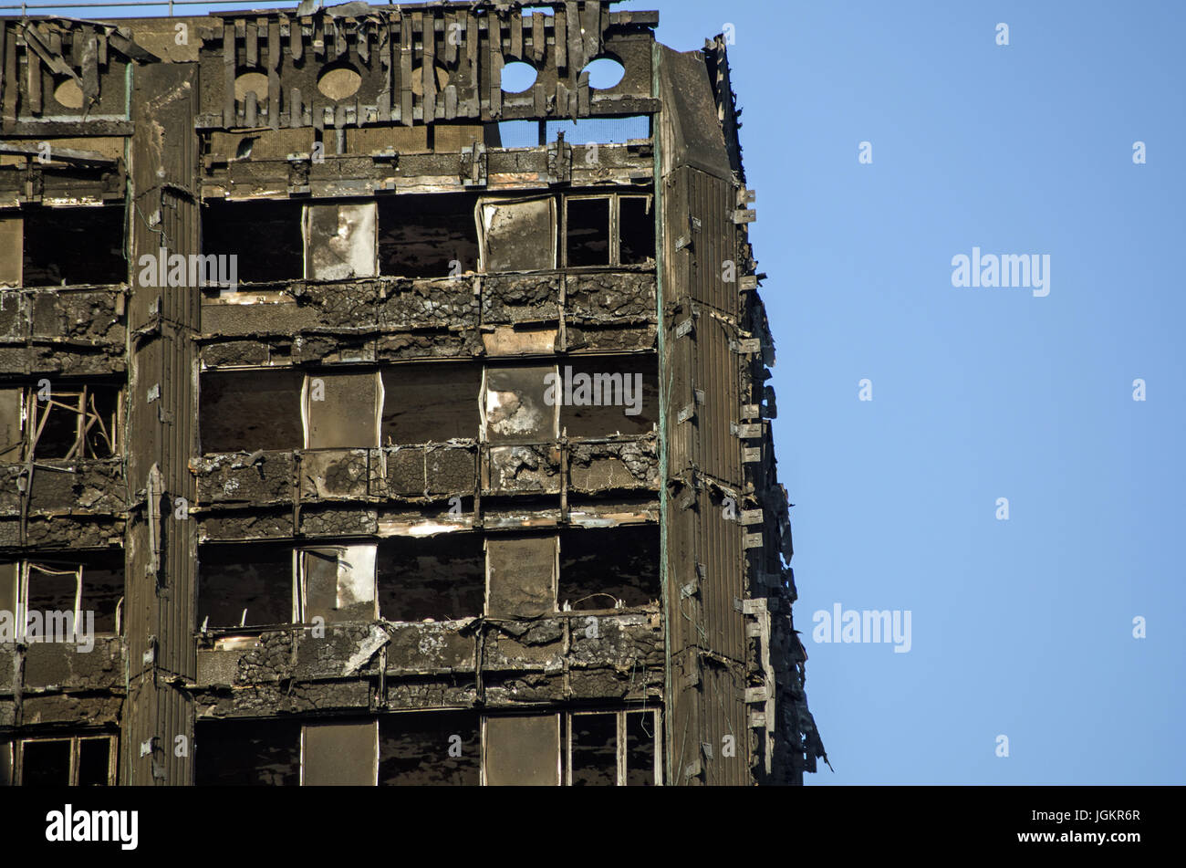 LONDON, UK - JULY 5, 2017: Part of the top floors of the Grenfell Tower block of council flats in which at least - Stock Image