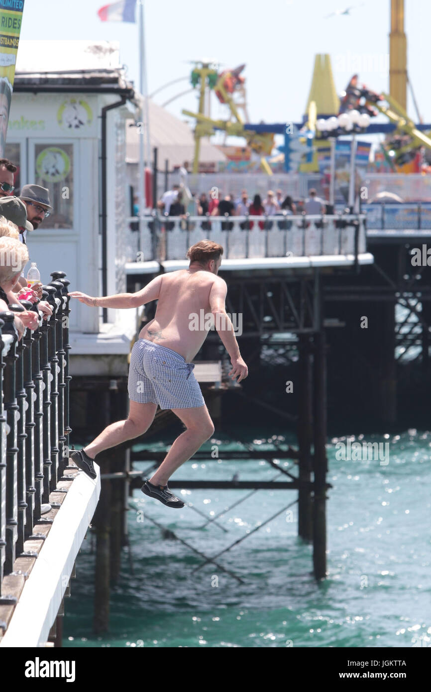 As the temperatures soar in Brighton East Sussex some take their life in their own hands. Stock Photo