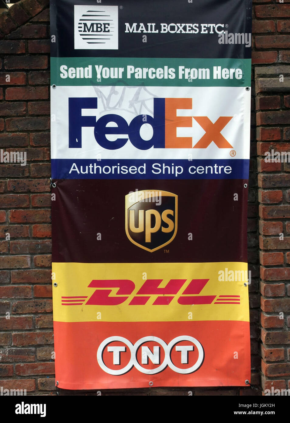 Courier companies' logos outside Mail Boxes Etc shipping centre in London - Stock Image