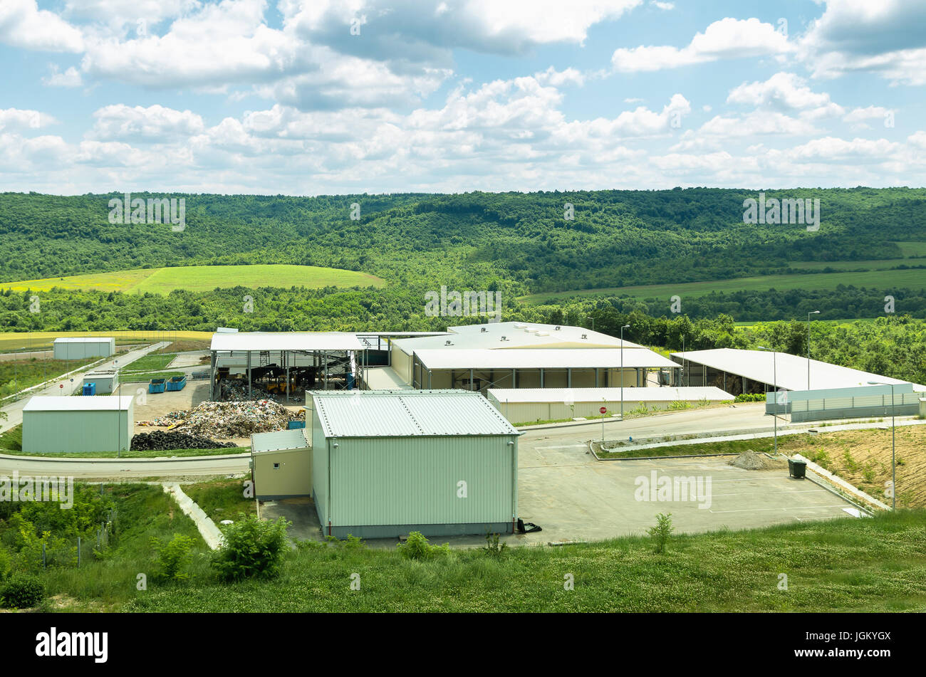 Urban landfill. Waste treatment plant depot, preparing it for separation. - Stock Image