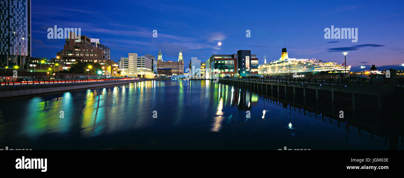 Panorama of Princes Dock Liverpool at night showing cruise liner berthed at Liverpool cruise terminal. Stock Photo