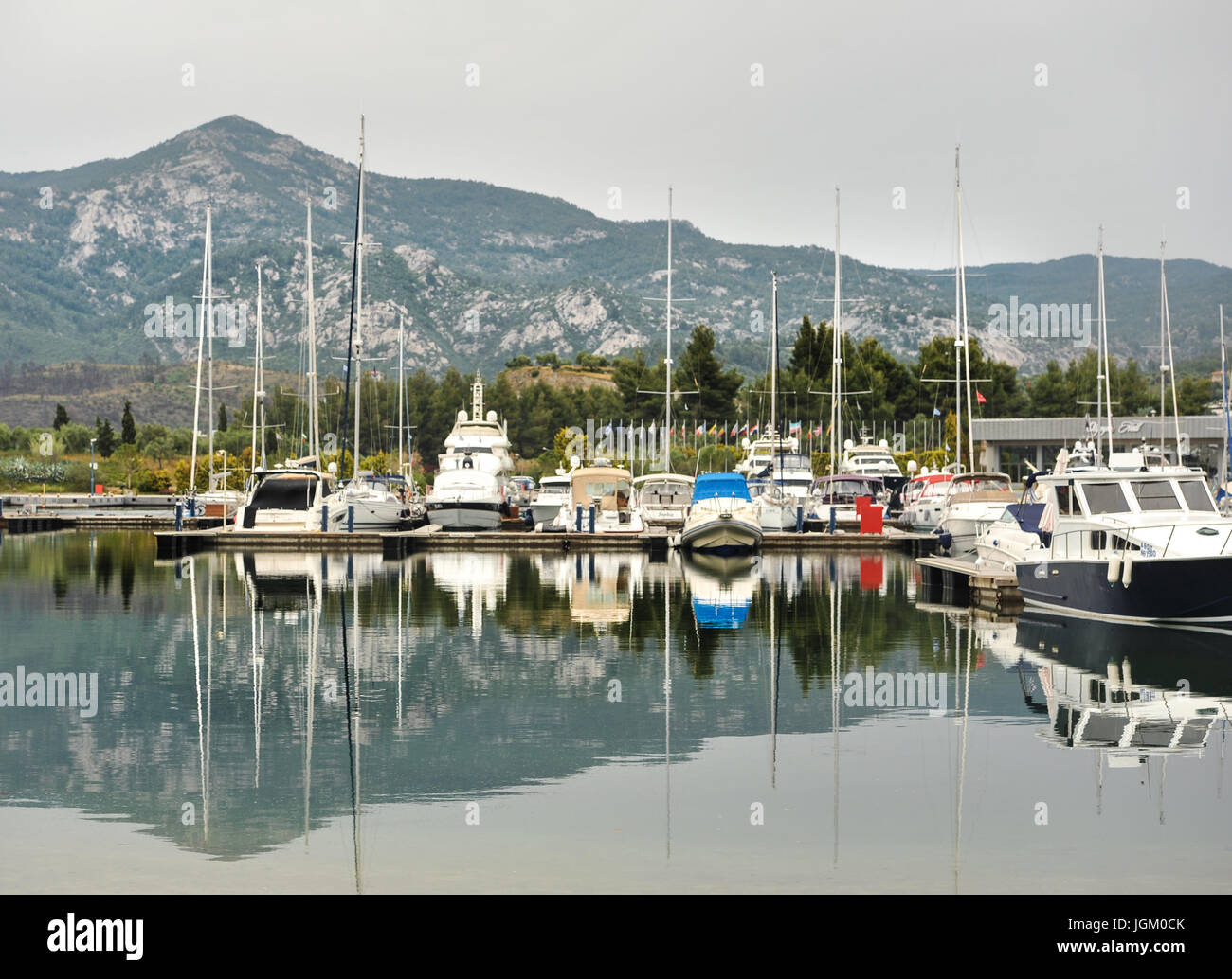Yachts anchored at the marina.Sailboat harbor, many moored sail yachts in the sea port, modern water transport,summertime Stock Photo