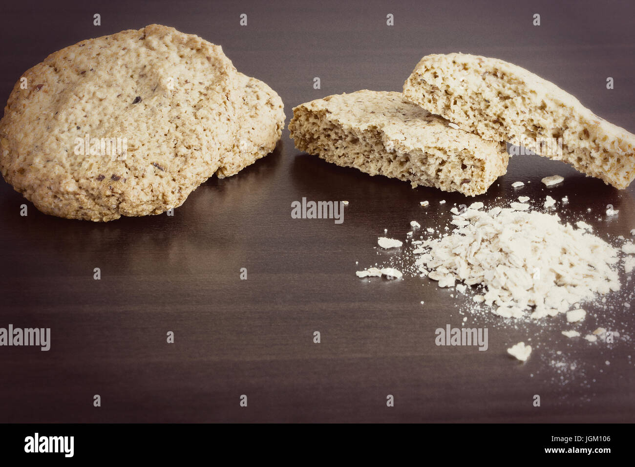 Homemade oatmeal cookie, healthy dessert, on dark background. Toned photo. Copy space. Selective focus - Stock Image