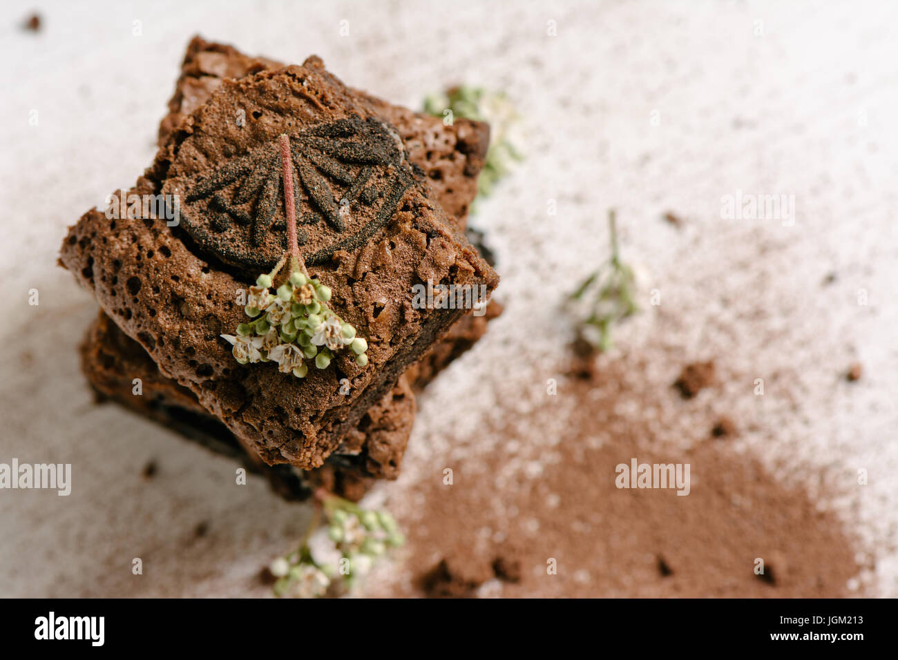 Chocolate brownies, with black biscuit stuffed with cream, stacked, from above Stock Photo
