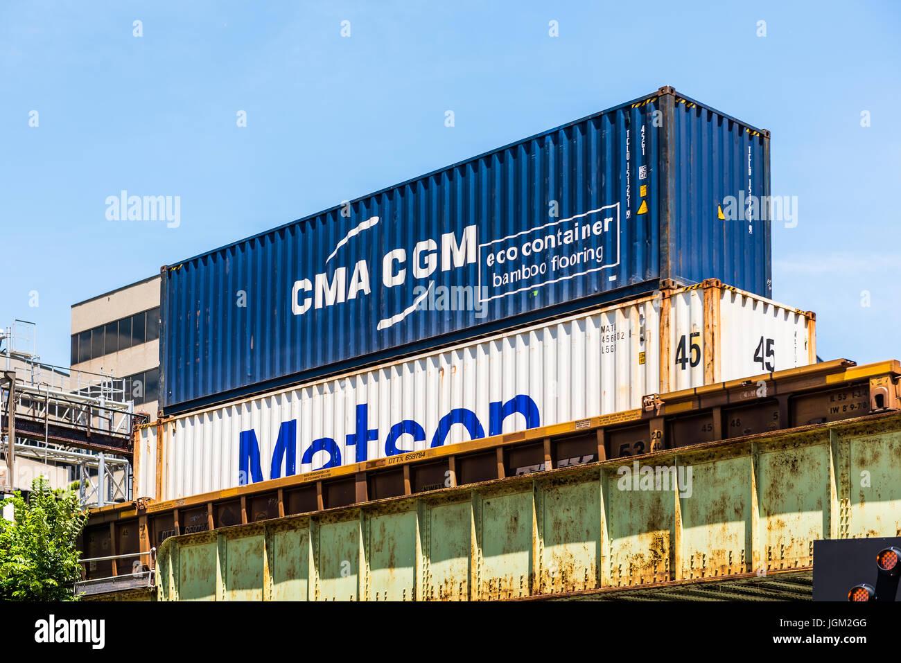 Washington DC, USA - July 3, 2017: CMA CGM Matson eco bamboo cargo shipping container on train - Stock Image