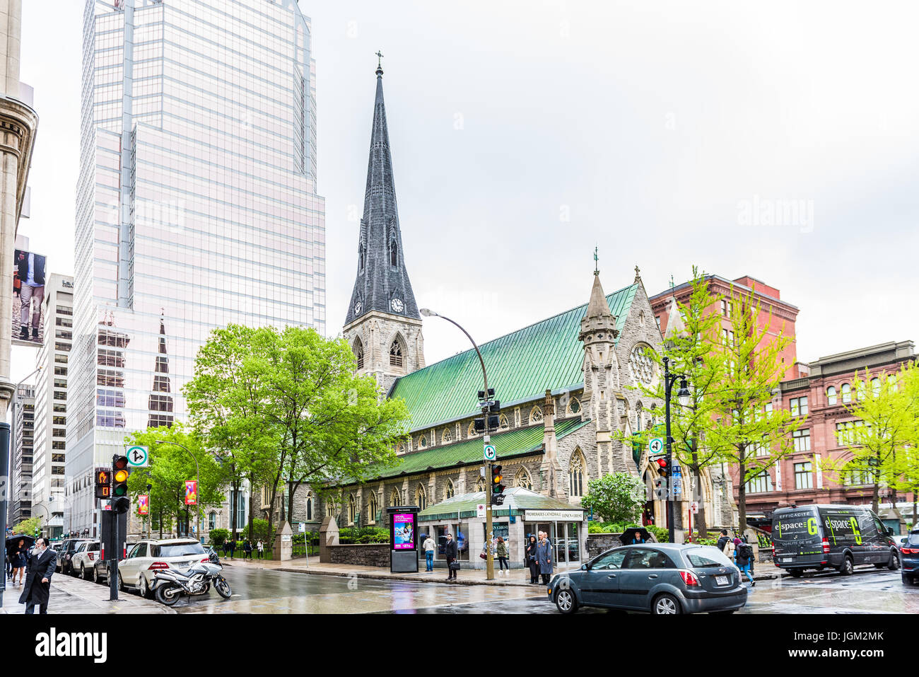 Montreal, Canada - May 26, 2017: Christ Church Cathedral and Promenades de la Cathedrale with KPMG building in downtown - Stock Image