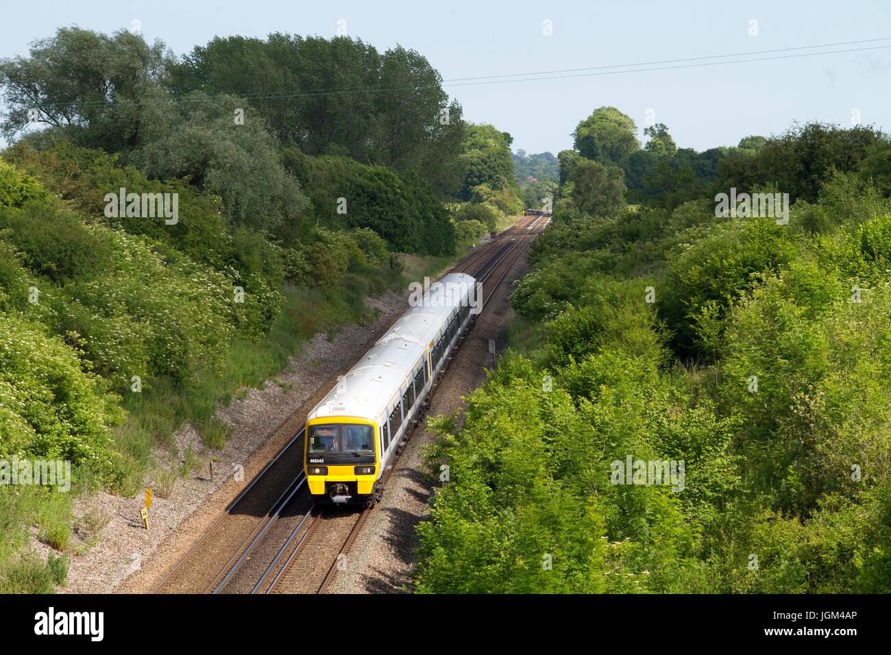 A pair of class 466 and class 465 Networker electric multiple unit operated by South Eastern Trains head east near - Stock Image