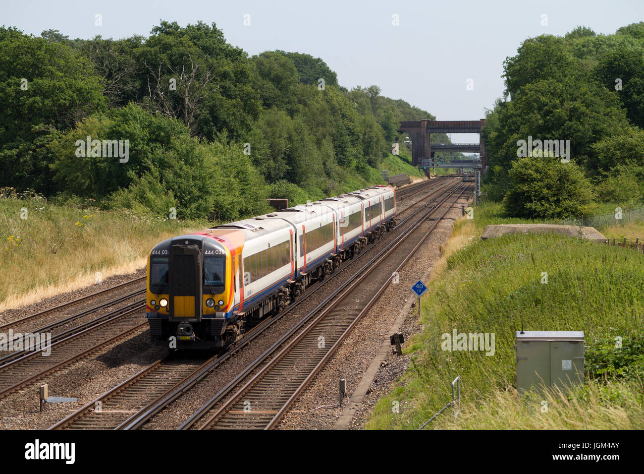 A class 444 Desiro express passenger electric multiple unit operated by South West Trains heads west at Potbridge Stock Photo