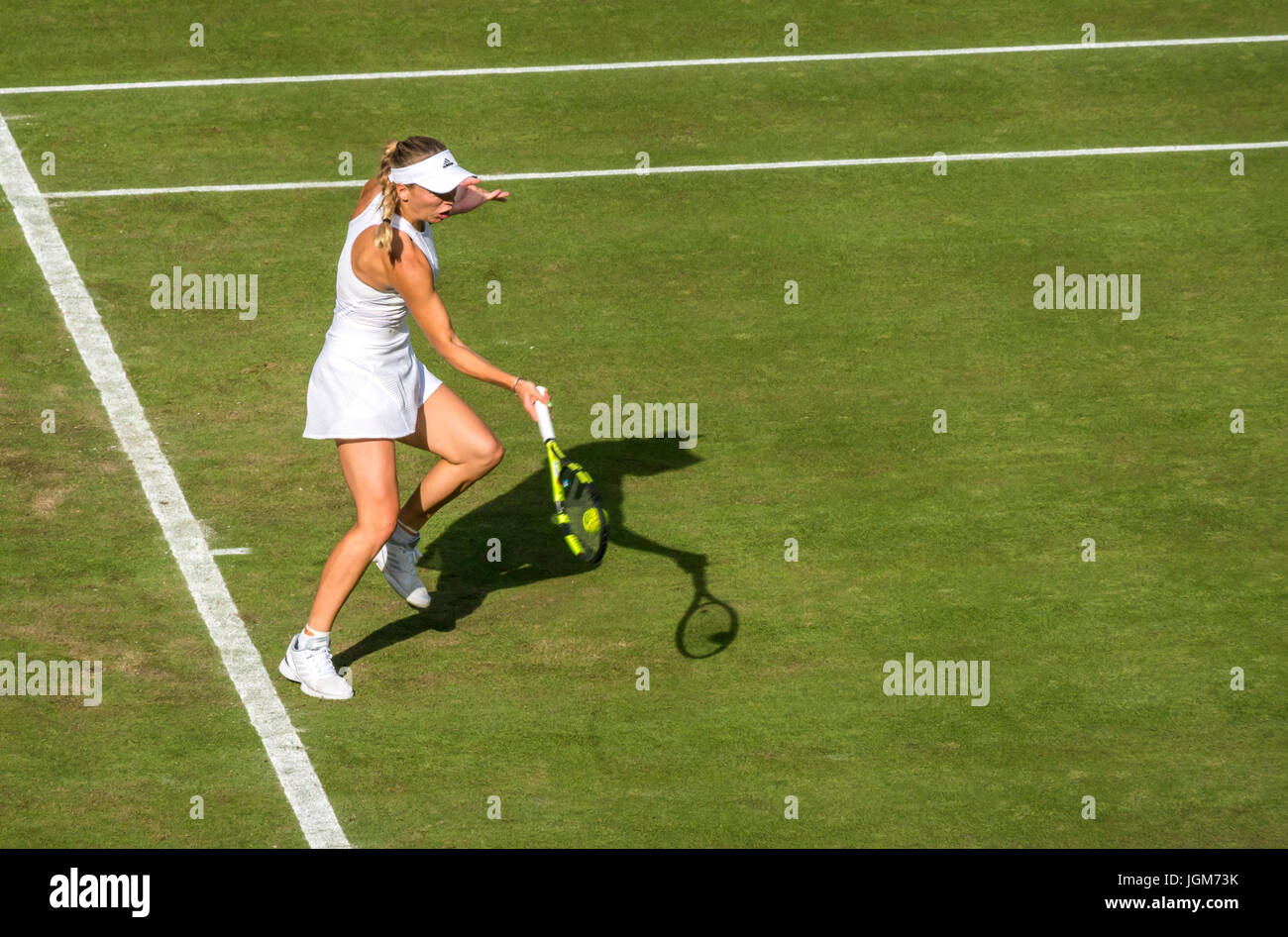 Caroline Wozniacki returns on Centre Court, Wimbledon 2017, ladies singles match, grand slam tennis champIonship, - Stock Image