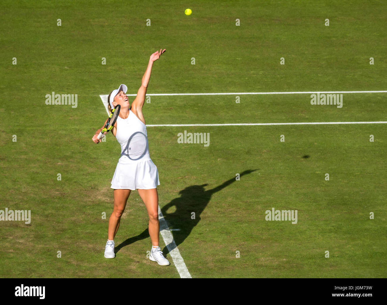 Caroline Wozniacki serving on Centre Court, Wimbledon 2017, ladies singles match, grand slam tennis champIonship, - Stock Image