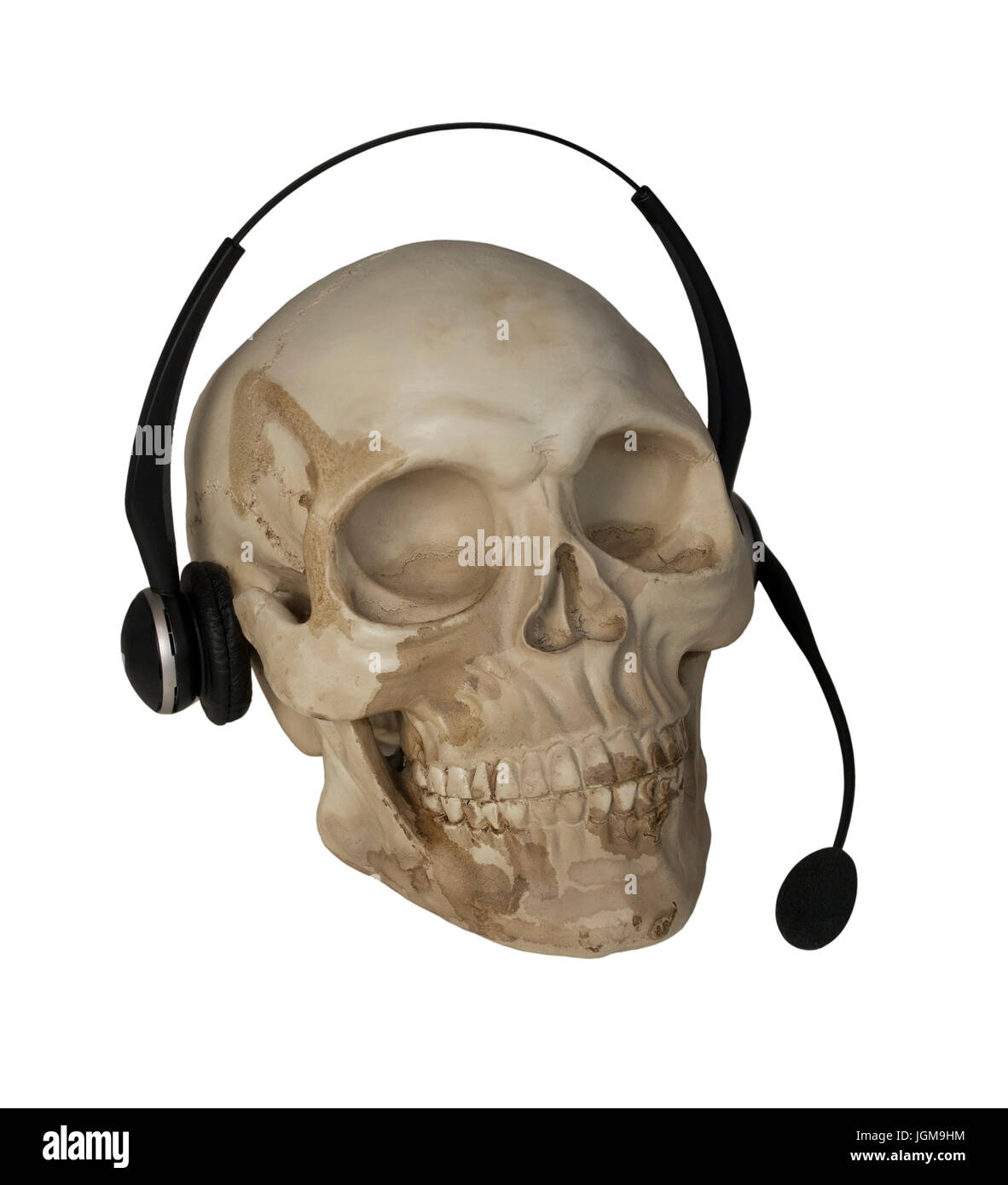 Audio microphone used to amplify communication On Skull - path included - Stock Image