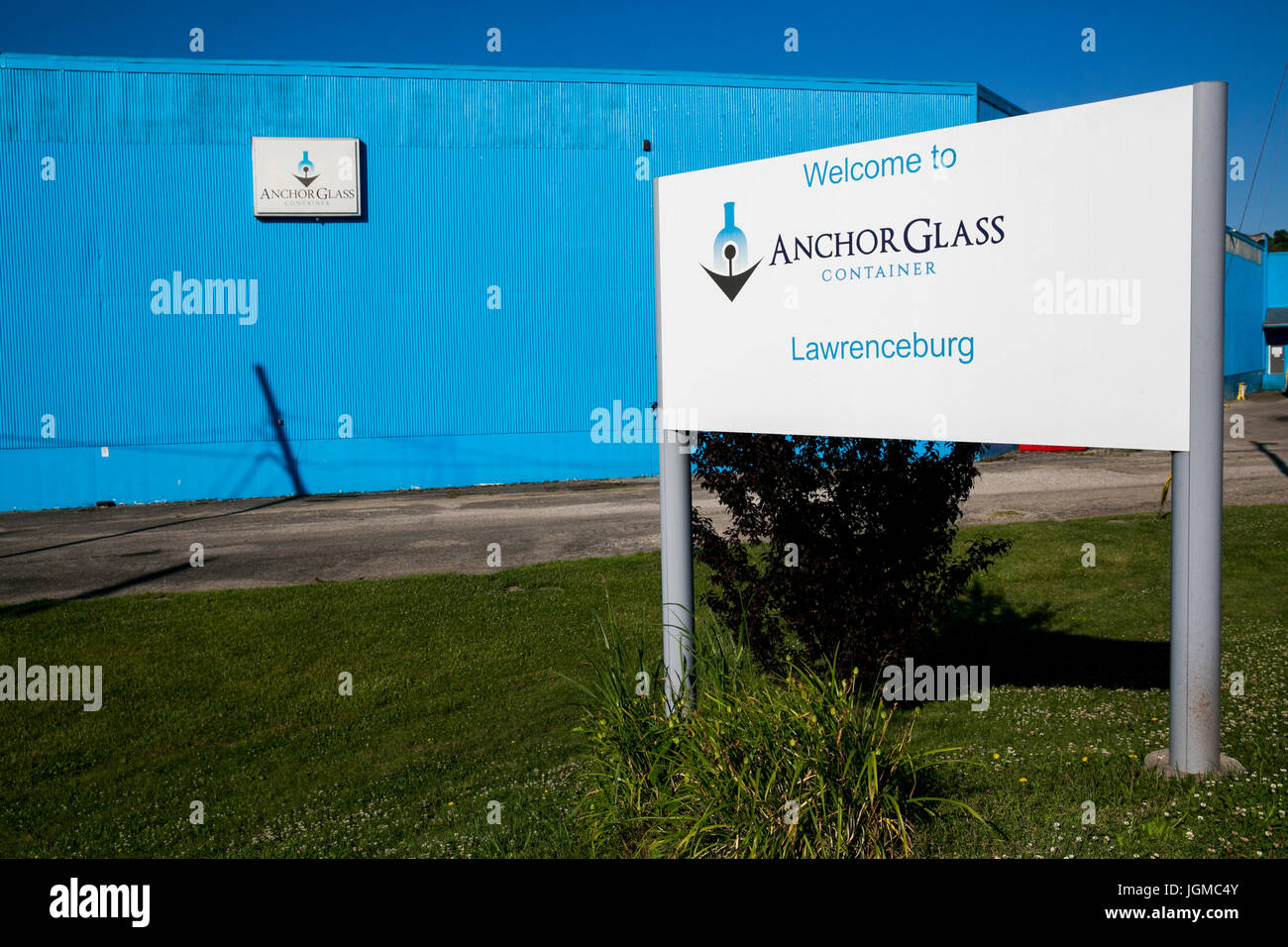 A logo sign outside of a facility occupied by Anchor Glass Container Corporation in Lawrenceburg, Indiana on July - Stock Image