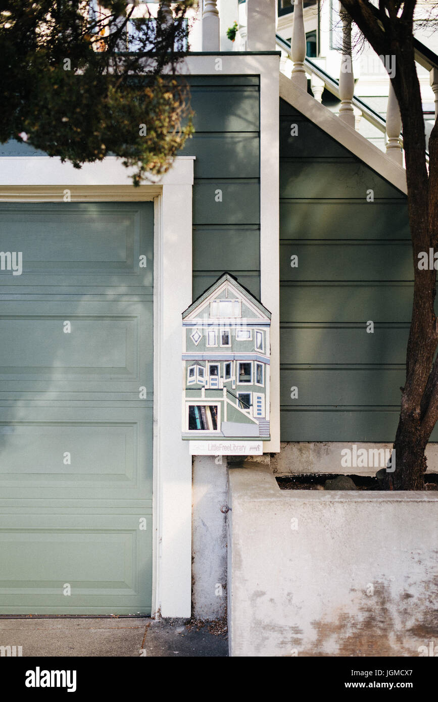 A tiny free library station attached to a house in San Francisco, CA - Stock Image