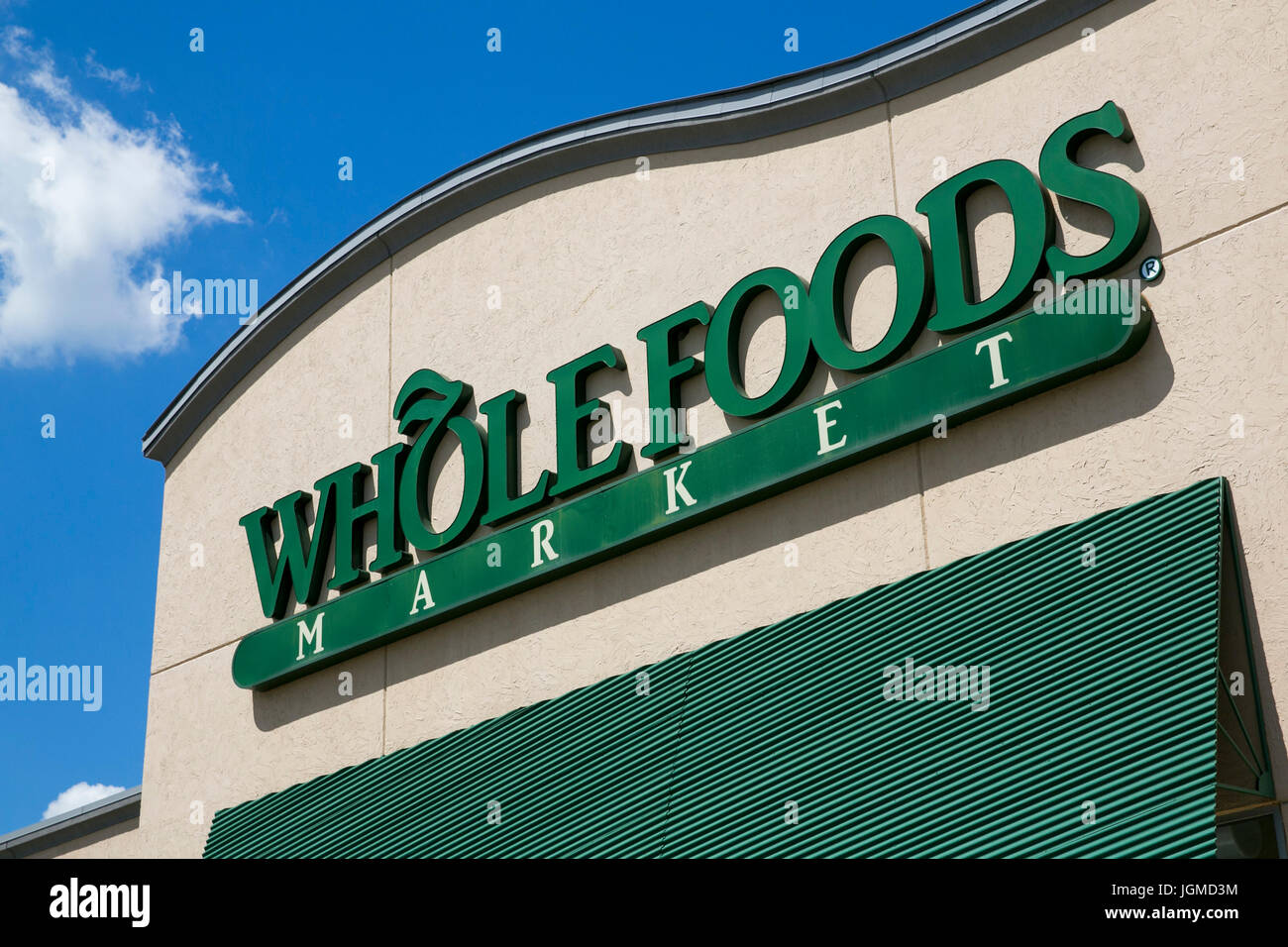 A Logo Sign Outside Of Whole Foods Retail Grocery Store In Mason Ohio On July 2 2017