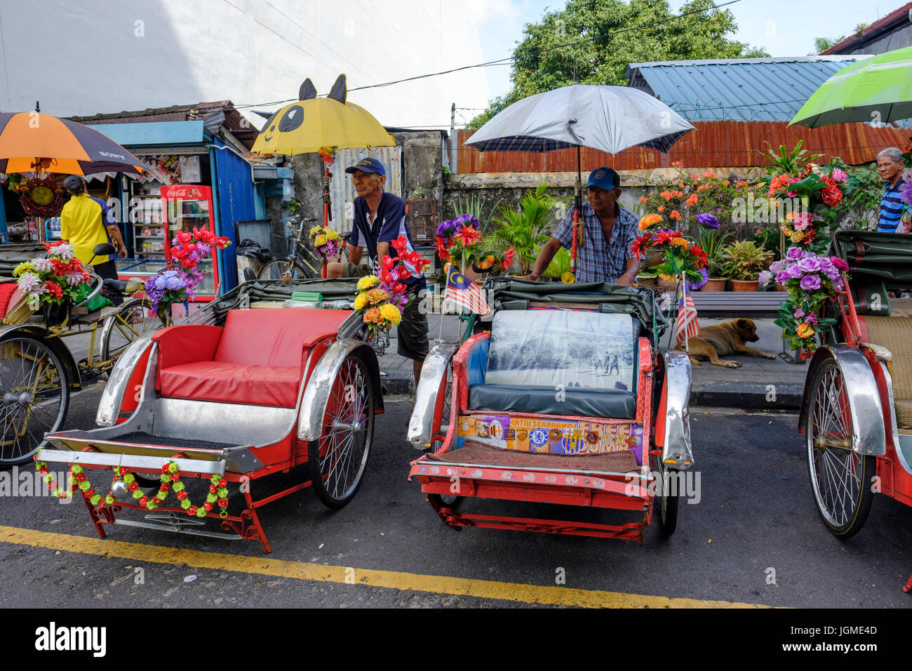 Trishaw (locally know as 'beca') drivers waiting for clients on the streets of George Town, Pulau Pinang, - Stock Image