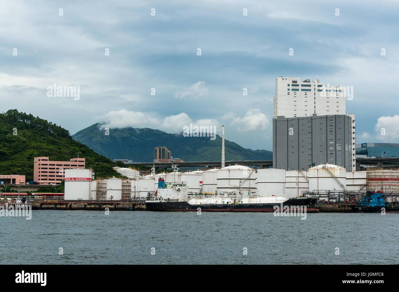 Crude oil storage tanks, Sinopec facility, in Hong Kong SAR - Stock Image