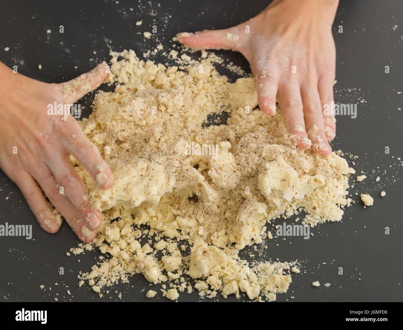 Woman kneads a dough from - Woman is baking, Frau knetet einen Teig ab - Woman is baking Stock Photo