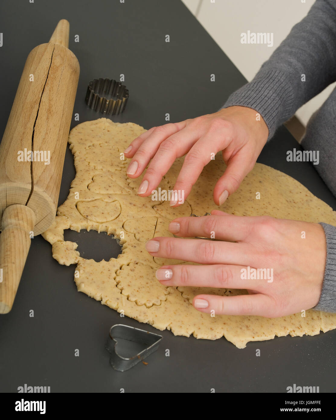Biscuits dig up - Punching out biscuits, Kekse ausstechen - Punching out biscuits Stock Photo