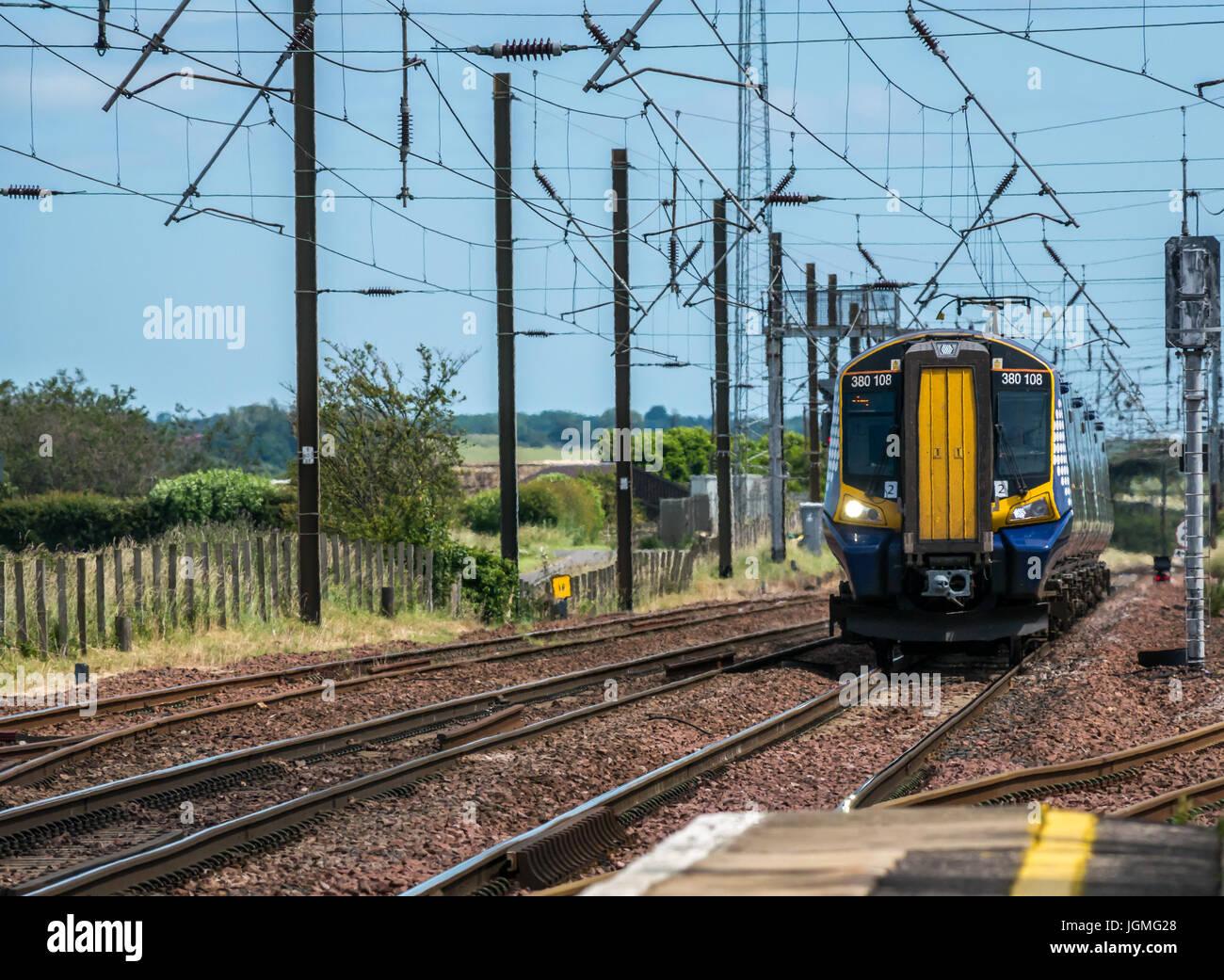 Scotrail train on North Berwick line approaching Drem train station, East Lothian, Scotland, UK - Stock Image