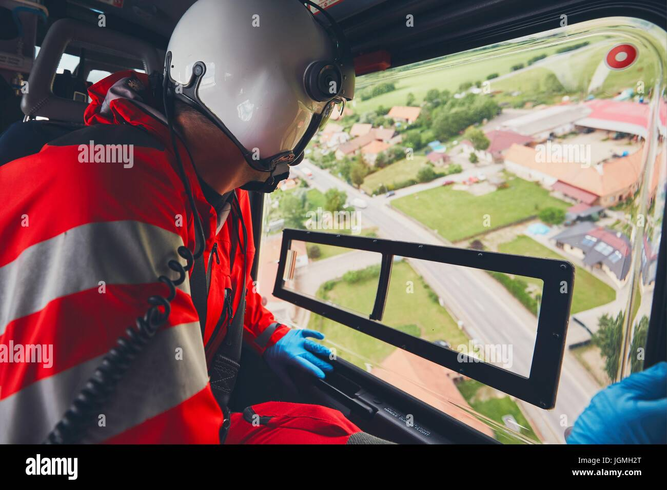 Alarm for helicopter emergency medical service. Doctor looking from window on the road. Theme rescue, help and hope. - Stock Image