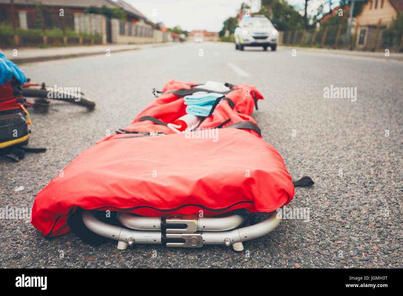 Stretcher on the road. Emergency medical service and and police teams are responding to an traffic accident Theme - Stock Image