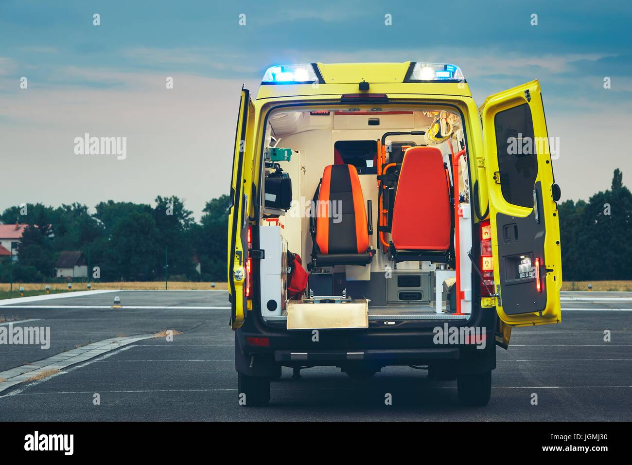 Ambulance car of the emergency medical service at night. - Stock Image
