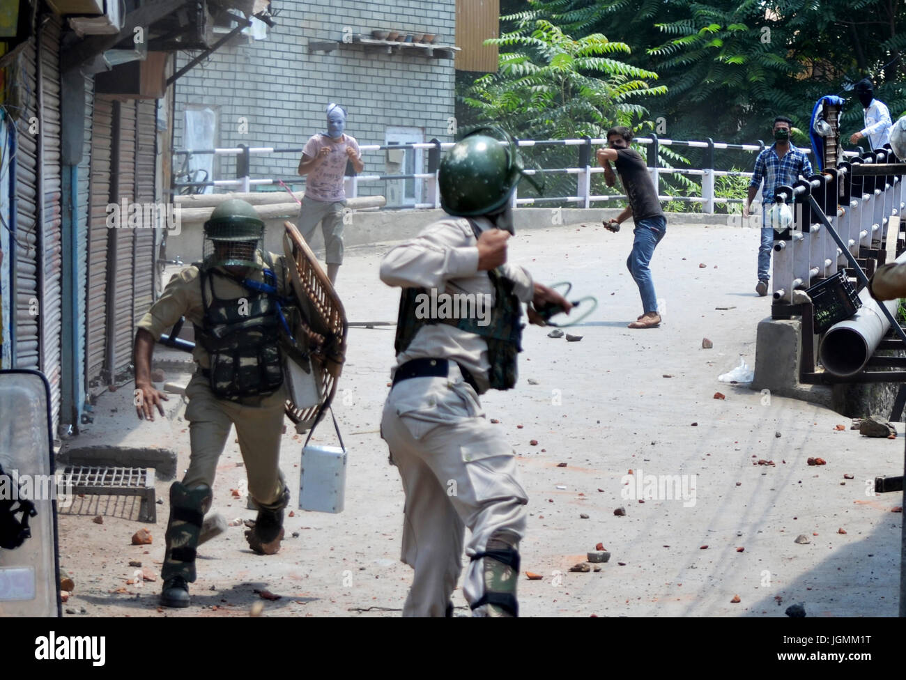 Kashmiri Muslim protestors clash with Indian Forecs during a protest on the first death aniversary of The Rebel - Stock Image