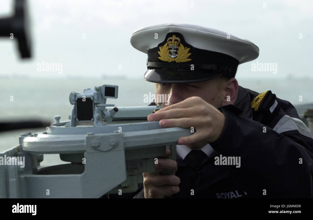 AJAXNETPHOTO. AT SEA, UK TERRITORIAL WATERS. - BEARING - ROYAL NAVAL OFFICER ON A FRIGATE TAKES A BEARING USING - Stock Image