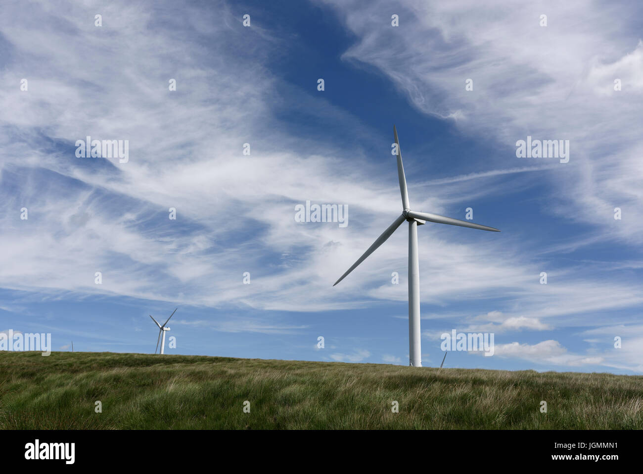 Wind turbine a source of renewable and sustainable energy at scout moor wind farm, with sky filled with wispy cirrus - Stock Image