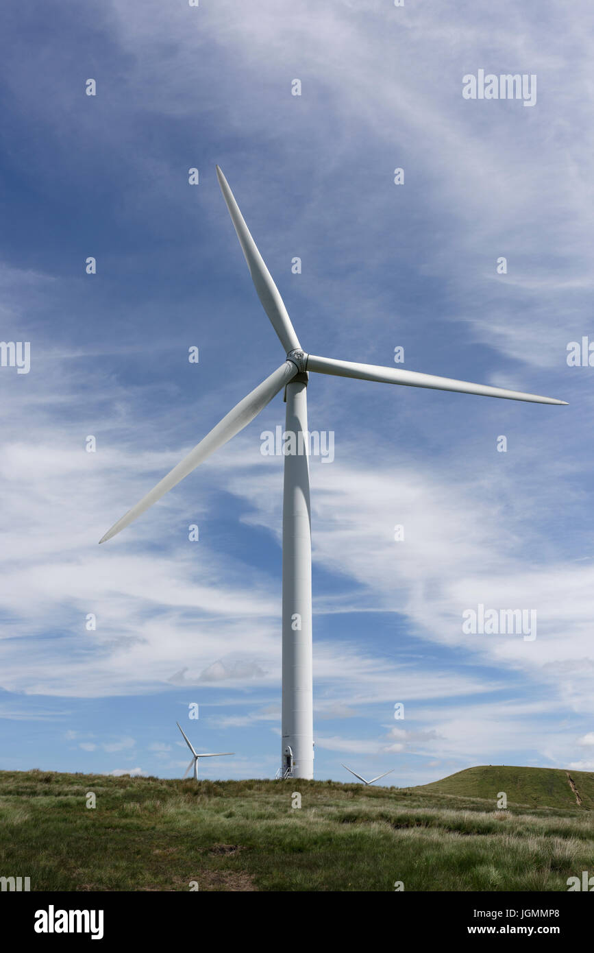 Wind turbine a source of renewable and sustainable energy at scout moor wind farm, with wispy cirrus clouds above - Stock Image