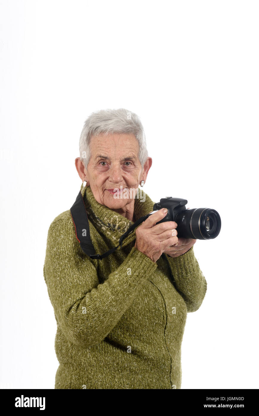 older woman with a SLR camera - Stock Image
