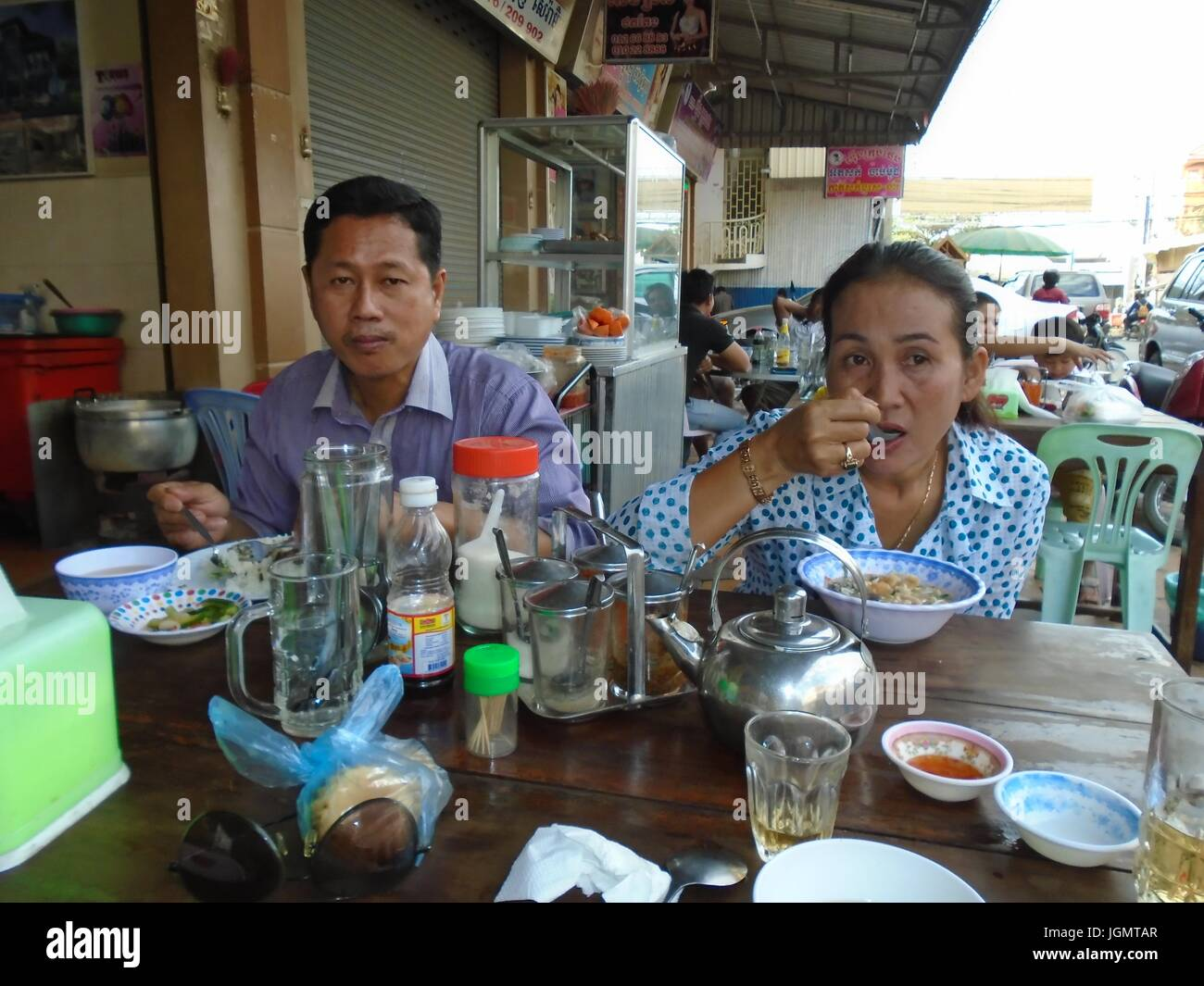 Supper meal in Poipet Cambodia Decrepit Impoverished Town on the Thailand Border Line Stock Photo