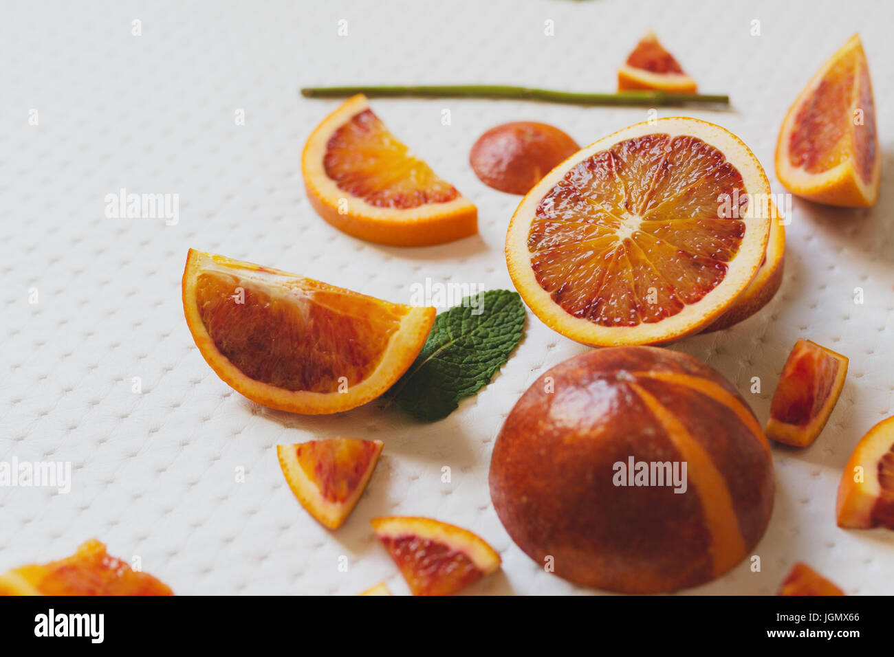 Juice of blood red oranges, freshly cut, fresh fruit - Stock Image
