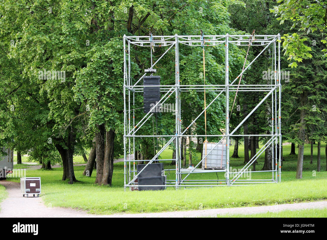 Metal structure in the form of a frame for attaching musical columns and a screen for broadcasting events in the park Stock Photo