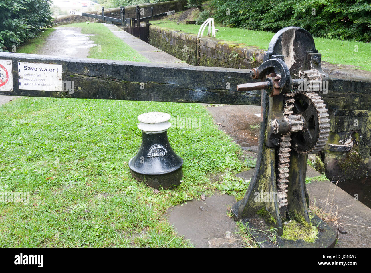 Lock gate mechanism on the Huddersfield Narrow Canal in Uppermill, Oldham, Lancashire, England, United Kingdom - Stock Image