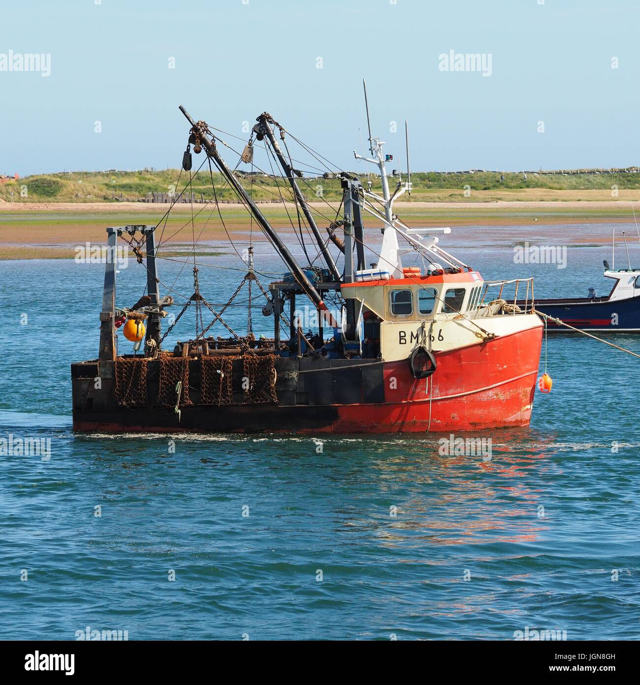 A scallop dredger moored up in the river Exe - Stock Image