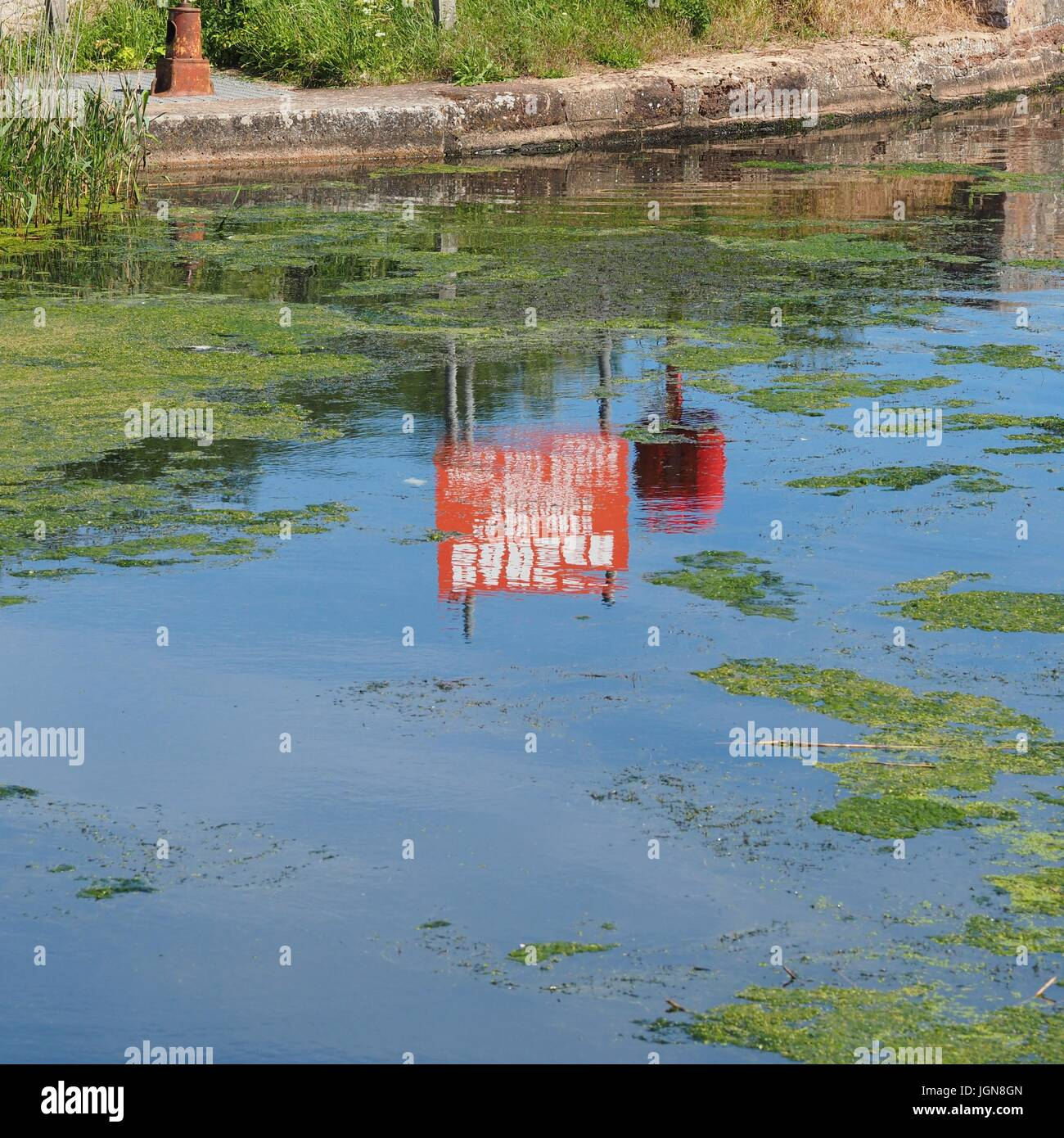 Danger do not drag anchor 11000 volt cable sign reflected in Exeter Canal Stock Photo