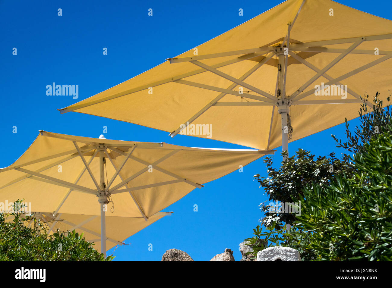 Parasols and Blue Sky - Detailed View, Looking from Beneath Bar Parasols at a Vivid Blue Sky: Baia Sardinia, Gallura, - Stock Image