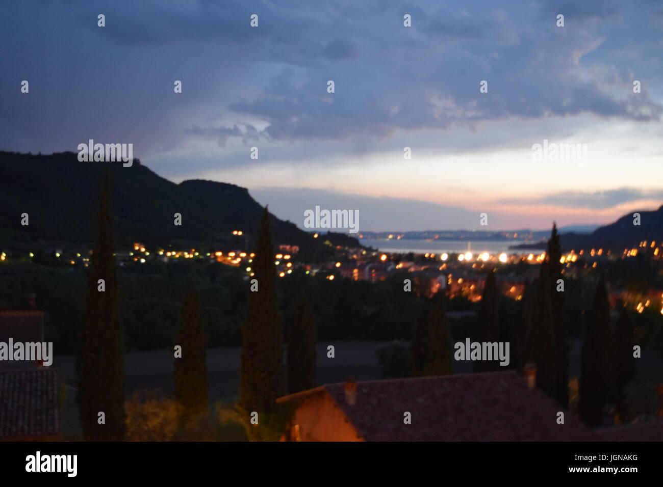 Gardasee bei Nacht, lake garda by night - Stock Image
