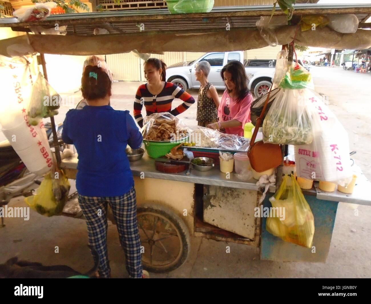 Street Vendor Push Cart Poipet Cambodia Decrepit Impoverished Town on the Thailand Border Line Stock Photo