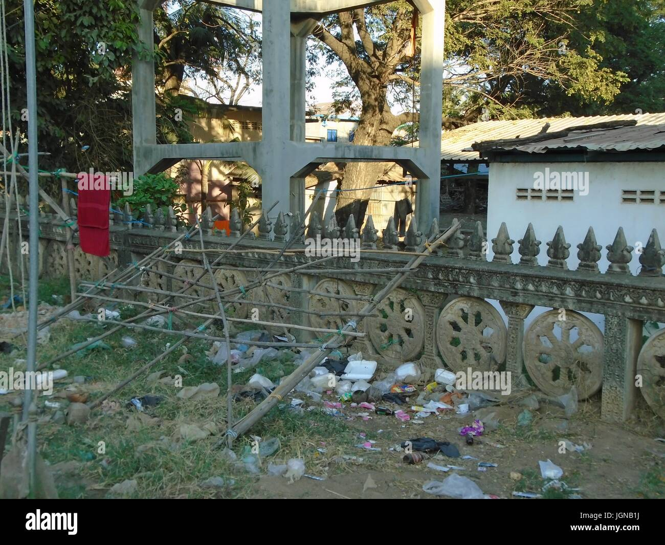Concrete Fence Decorative Traditional Poipet Cambodia Decrepit Impoverished Town on the Thailand Border Line - Stock Image