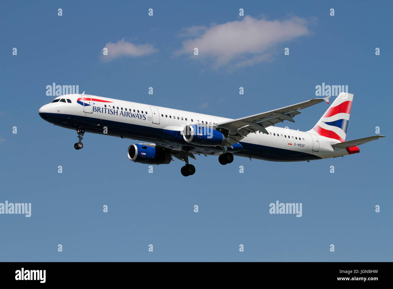 Civil aviation. British Airways Airbus A321-200 passenger aeroplane on approach against a blue sky - Stock Image