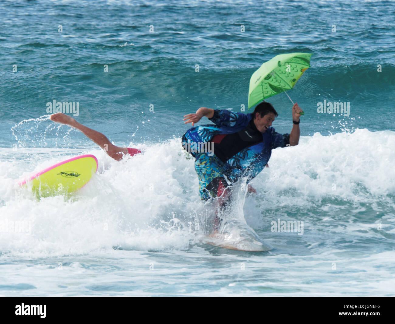 Surfing  fun fancy dress surfers Stock Photo