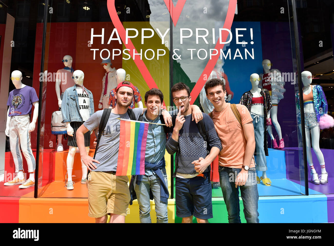 London, UK. 08th July, 2017. Tourists posed photo in front of Top Shop during Pride In London on Saturday. Photo - Stock Image