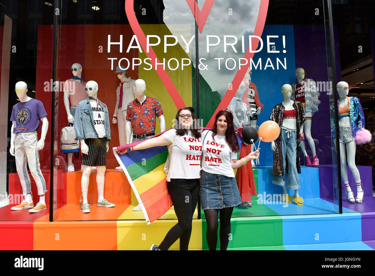 London, UK. 08th July, 2017. Two girls posed a photo in front of the Top Shop on the Oxford Street during Pride - Stock Image