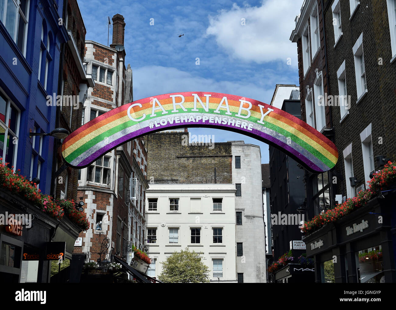 London, UK. 08th July, 2017. London's famous shopping street - Carnaby Street also decorated in the Rain Bow - Stock Image